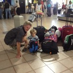 "Tim and Jack waiting for the ""cargo"" shipment of luggage on St. Thomas"