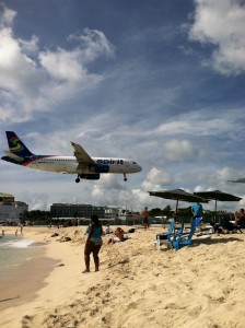 St. Martin airport is quite unique, the runway is very close to the beach and the planes come overhead ... great for pictures ... there is a bar on either end. Very cool