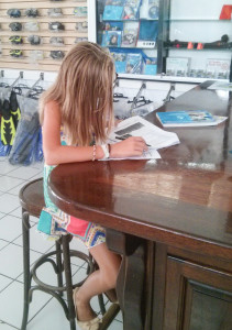 Kate taking her written exam for her scuba ticket. She now has 8+ dives.
