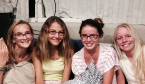 Four teenage girls off of four boats, for movies and a sleep over in Grenada.